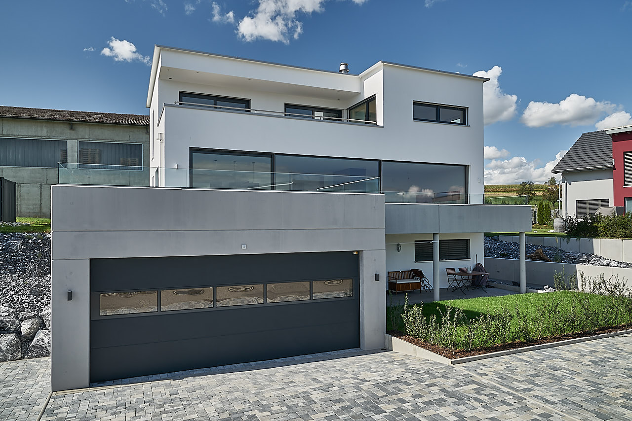 Einfamilienhaus mit einliegerwohnung und doppelgarage for Einfamilienhaus mit doppelgarage